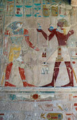 Deir Al Bahari, Temple of Hatshepsut, Queen Hatshepsut offering gifts to the god Horus, Ancient Thebes, Luxor, Egypt