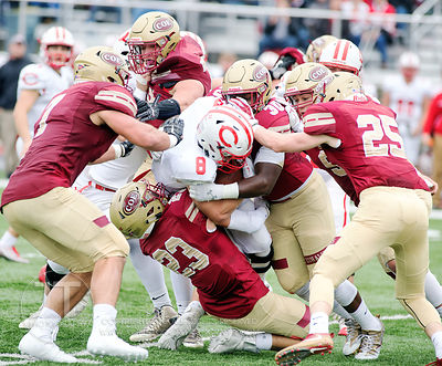 Coe College's Terrence Hall (30) and Brian Robertson (23) lead on a tackle of Central's Pat Gray (8) during the first half of...