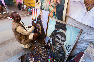 Painter doing self-portraits for sale to tourists, Pushkar, Rajasthan, India