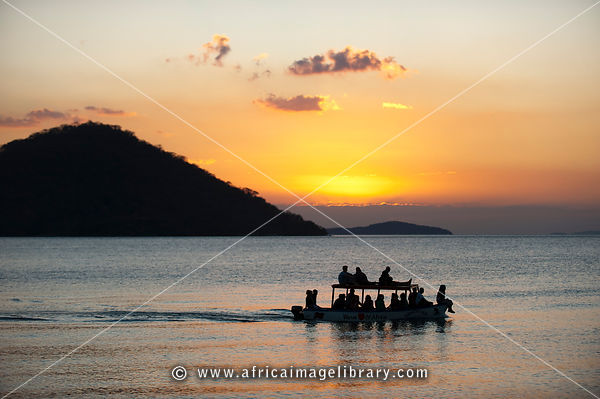 Tourist boat at sunset on Lake Malawi, Cape Maclear, Malawi