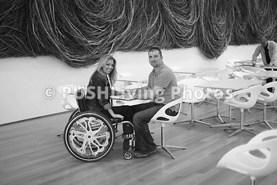 Woman using a wheelchair visiting the Raleigh Museum of Art with her Husband