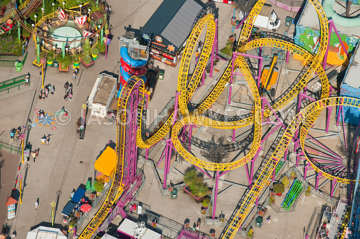 Aerial view over fun fair / theme park.