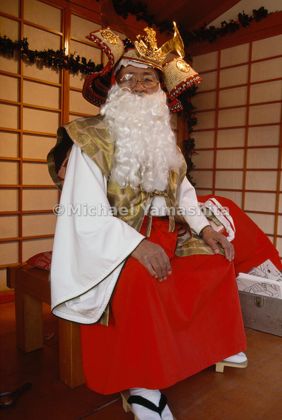 "In Los Angeles' Little Tokyo district, Jiro Uchida adds a beard to traditional garb to play ""Shogun Santa."" In like fashion, ..."