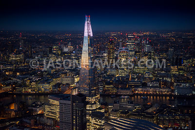 Aerial view of London, London Bridge Station with 20 Fenchurch Street and Tower 42 at night time.