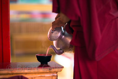 A monk pours tea at the Matho Gompa, Matho village, Ladakh, India