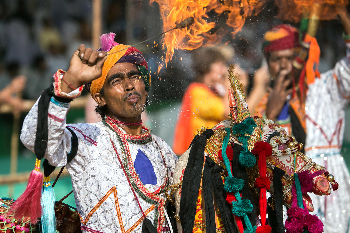 A performer breathes fire during the Pushkar Camel Fair, Pushkar, Rajasthan, India