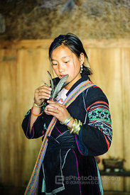 Young Hmong Woman Making Feathered Hacky Sacks