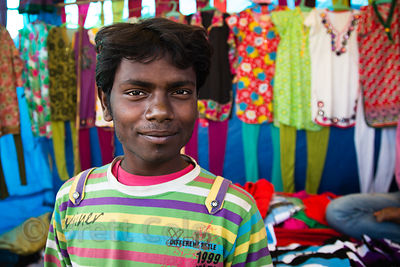 Colorful salesman at a colorful clothing stall, Pushkar, Rajasthan, India