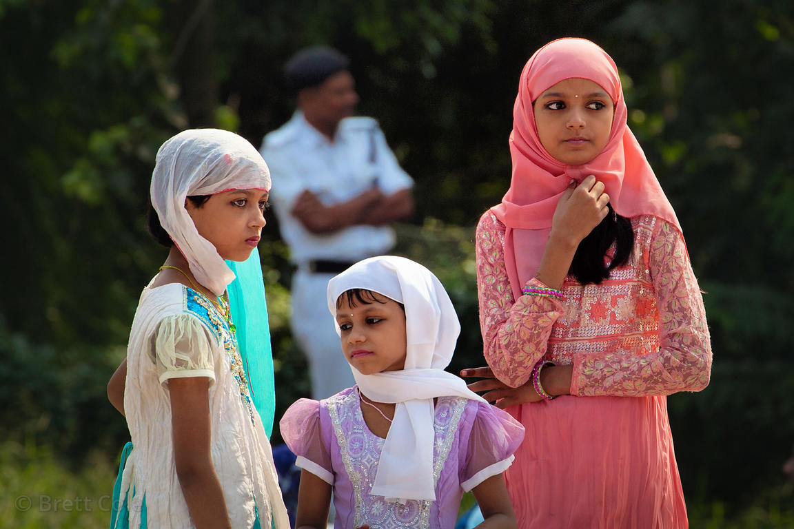 Three sisters at the observance of Eid al-Adha on Red Road in Kolkata, India. Eid al-Adha is the most important Muslim holida...