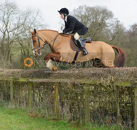 Tom Chatfeild-Roberts jumping a hedge