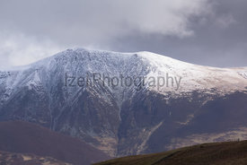 Summit of Skiddaw in the Lake District after a late snow shower in spring