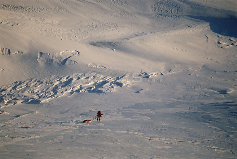 Man pulling sledge during filming for polar bear sequence of BBC tv series Planet Earth, Kong Karls Land, Svalbard archipelag...