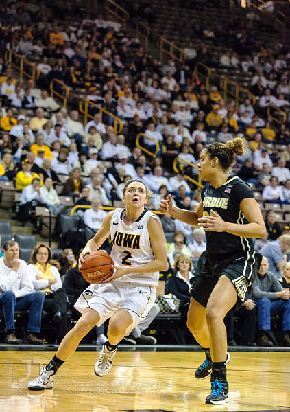 Iowa's Aly Disterhoft (2) drives to the basket versus Purdue's Whitney Bays (32) during the second half of play at Carver-Haw...