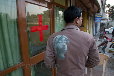 Local doctor with an image of hip-hop legend Tupac Shakur on his jacket, Pushkar, Rajasthan, India