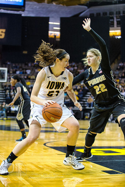 Iowa's Bethany Doolittle (51) drives against a defending Purdue's Bree Horrocks (22) during the first half of play at Carver-...