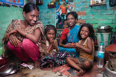 A family shares their tiny house in the Fakir Bagan slum area of Howrah, India. Average home size in some parts of the city i...