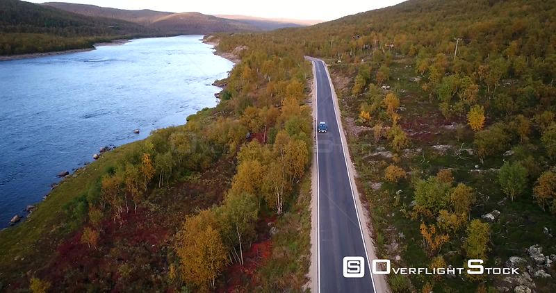 Autumn Color Road, Aerial View of a Car Driving on Road 970 the Tenontie, Near Tenojoki River, at the Border of Norway and Ut...