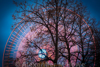 The big wheel turning behind trees at Oslo's WInter Wonderland