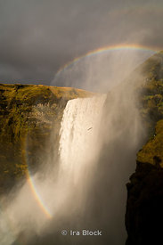 Rainbow across the Skogafoss Waterfalls on the Skógá River in the south of Iceland.