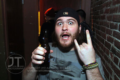 A bar patron reacts to the camera at the Airliner Bar, 22 S Clinton Street in downtown Iowa City Saturday night. Copyright Ju...