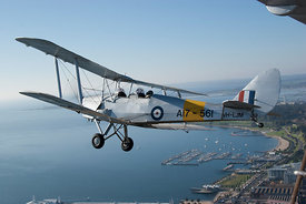 Tiger Moth flying over Geelong Harbour