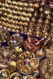 Metal goods for sale at a market in Kalighat, Kolkata, India.