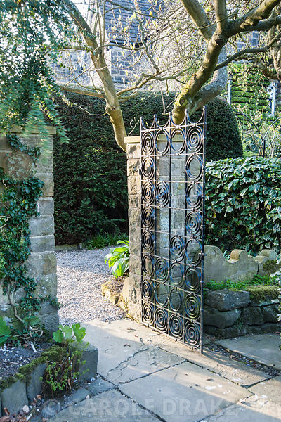 Gate into the pinetum. York Gate Garden, Adel, Leeds, Yorkshire