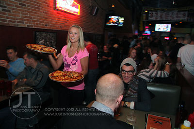 A server prepares to box up pizza for customers at the Airliner Bar, 22 S Clinton Street in downtown Iowa City Saturday night...