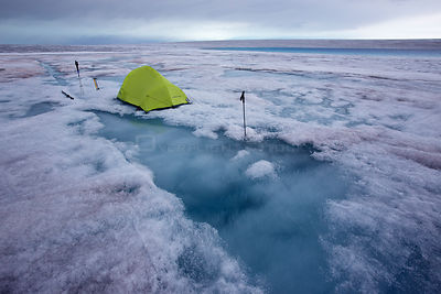 Base camp at meltwater lake on ice cap north-east of Sermeq Kujalleq Glacier,   Ilulissat Icefjord UNESCO World Heritage Site...