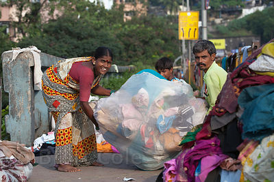 An outdoor laundry operation in a slum area in Antop Hill, Mumbai, India.