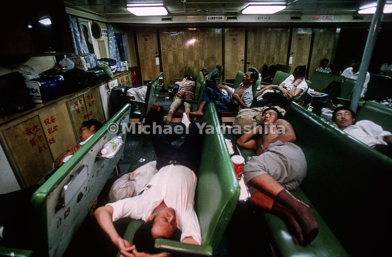 Ferrying between two of China's laboratories of free enterprise - Haikou and Beihai - workers sleep away a 12-hour journey th...