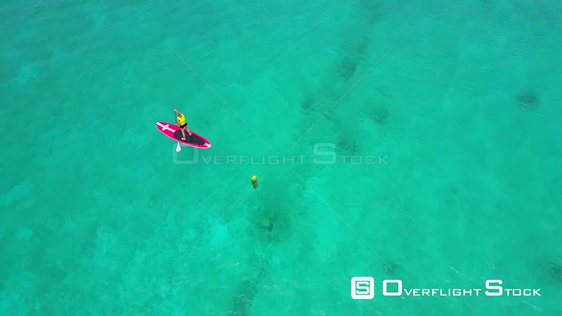 Paddle Boarder on Caribbean Ocean Cayman Islands