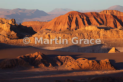 View across the Amphitheatre of the Valley of the Moon from Duna Mayor as the sun is setting, Atacama, Region ll Antofagasta,...