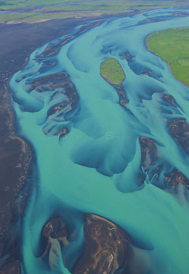 Aerial view of Olfusa river and estuary with blue water of melting glaciers, Southeast Iceland, July 2009