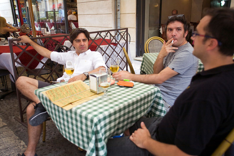 Italy - Verona - Men drinking beer at a cafe in the streets