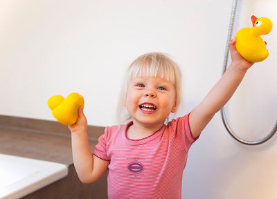 Toddler girl playing with rubber ducks