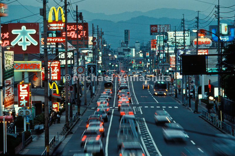 The aping of America can be found along almost any roadway. This garish street in suburban Fukuoka, a corridor that, for chao...