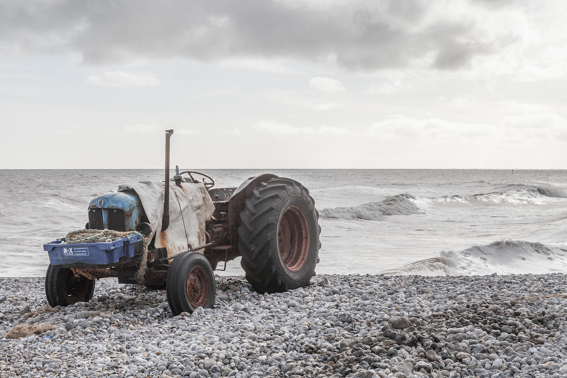 Tractor on pebble beach, Cromer
