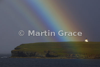 Lighthouse on the Brough of Birsay with rainbow, West Mainland, Orkney Islands, United Kingdom