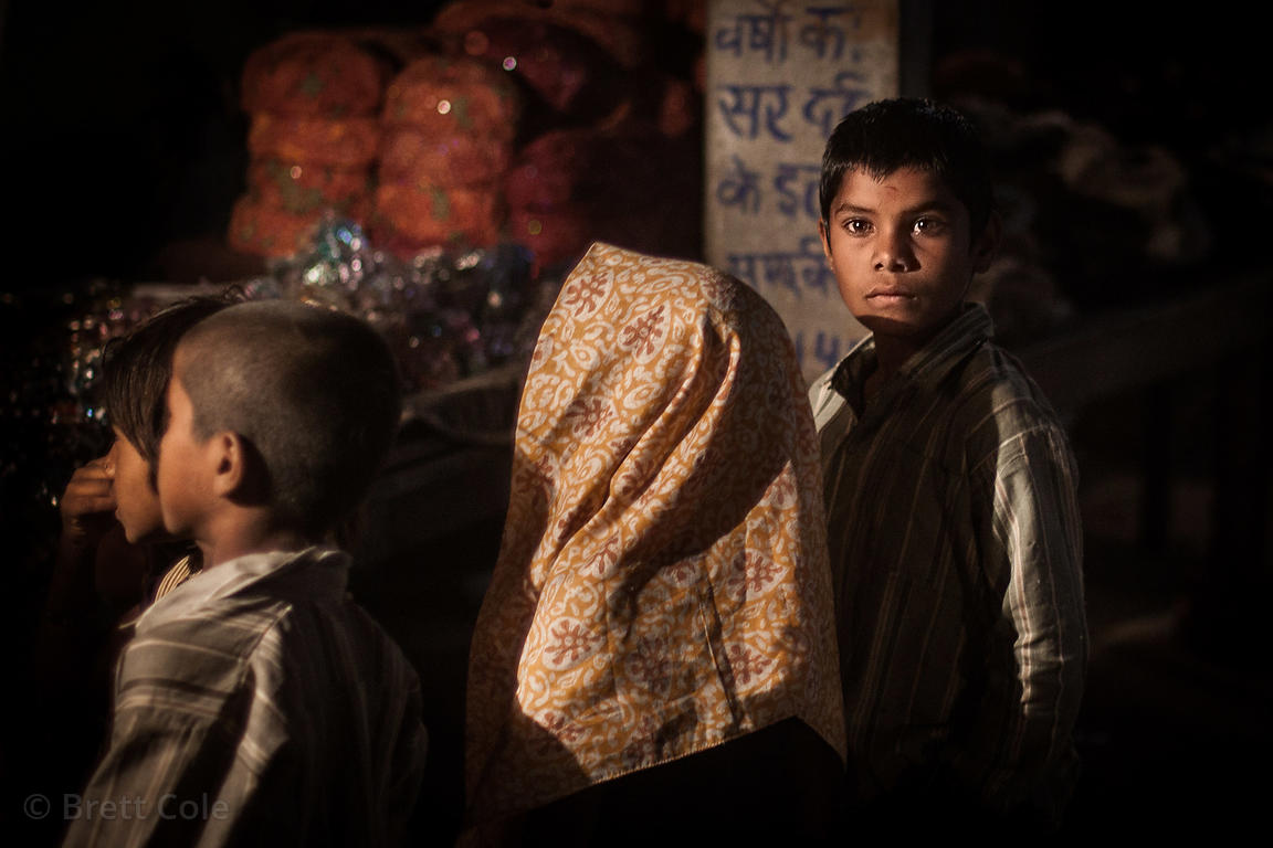 Nighttime portrait of carnival goers at the Pushkar Camel Mela, Pushkar, India.