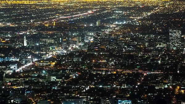 Bird's Eye: Close Up Of Hollywood's Corridor Amongst Streets, Blocks, & City Lights of L.A.