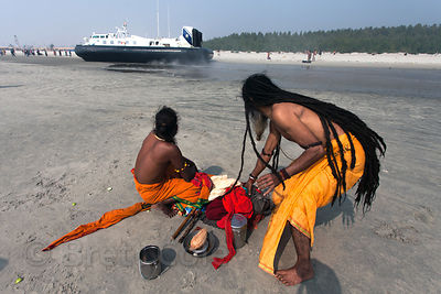 An Indian Navy hovercraft shuttles VIPs out of the Gangasagar Mela, a Hindu pilgrimage to Sagar Island in the Bay of Bengal i...