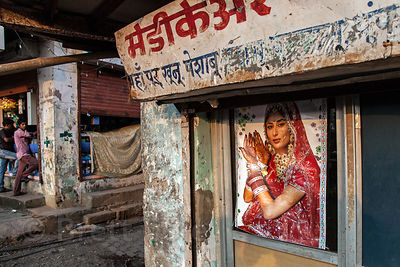 Advertising poster of a Hindu woman decked out in finery on a building in Antop Hill, Mumbai, India.