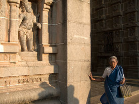 An old woman enters the Nataraja Temple