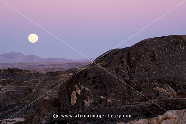 sunset over the rocky desert in the Diamond Coast Recreation area, Luderitz peninsula, Namibia