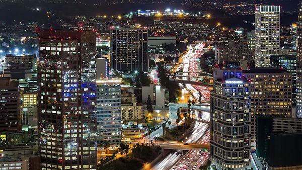 Bird's Eye: Medium View of Los Angeles Highway Snaking Through the Lights of Downtown