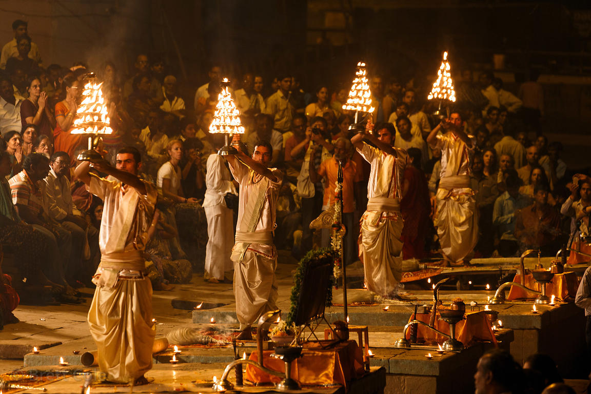 Pujari wave candles during Ganga Aarti, Dashashwamedh Ghat, Varanasi, India