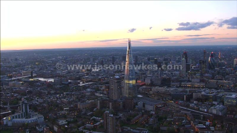 Aerial footage of The Shard and the City of London at dusk, England, UK