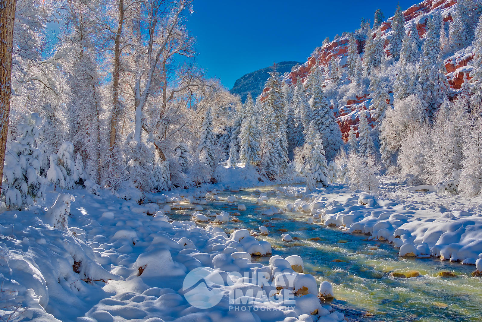 Uncompahgre River blue skies after the snow storm