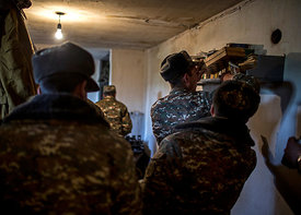 A group of young Armenian soldiers meet in their dormitory at the Madaris military base in southern Karabakh, on April 8, 2016.